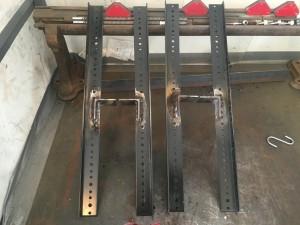 Custom welded rack rails side view.